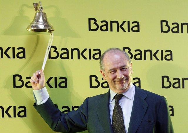 Rodrigo Rato, chairman of Spanish savings bank Bankia, rings a bell during its b