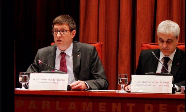 El conseller de Justícia, Carles Mundó, y su antecesor, Germà Gordó, en comisón