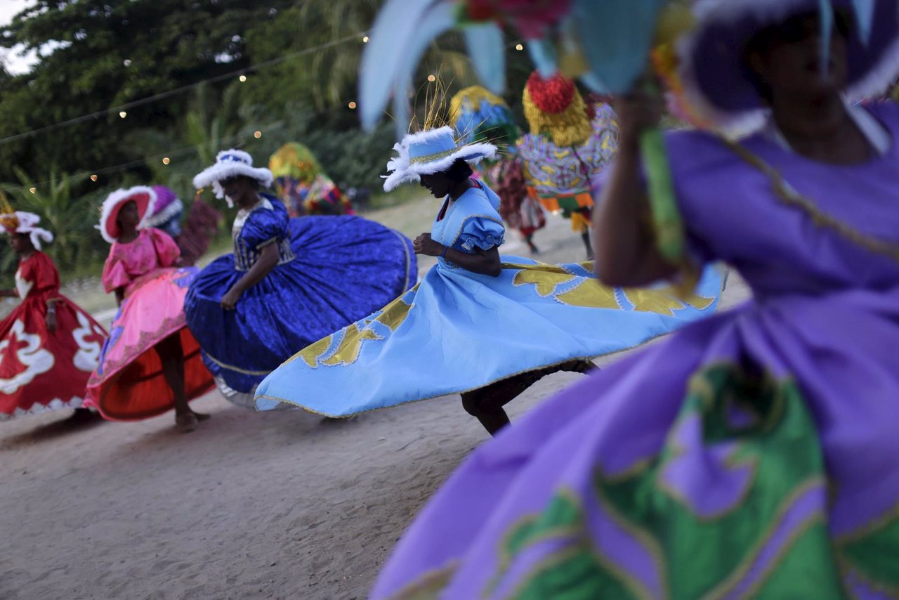 Revellers dance during a traditional Maracatu carnival in Olinda