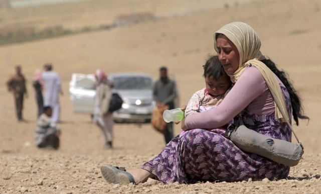 A displaced woman and child from minority Yazidi sect, fleeing violence from for