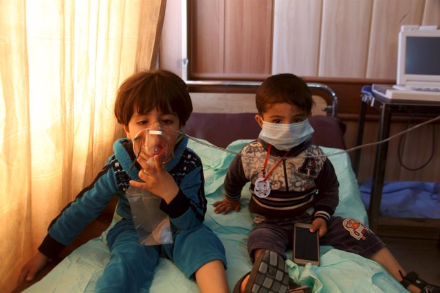 Children receive oxygen, after suffering from choking, at a hospital in Taza sou