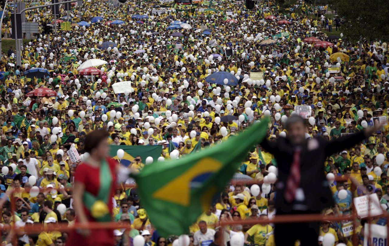 Demonstrators attend a protest against Rousseff in Brasilia