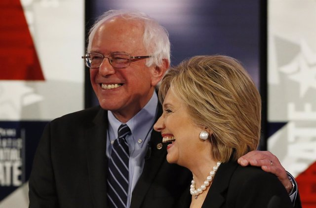 Democratic U.S. Presidential candidate Clinton shares a laugh with Sanders at th