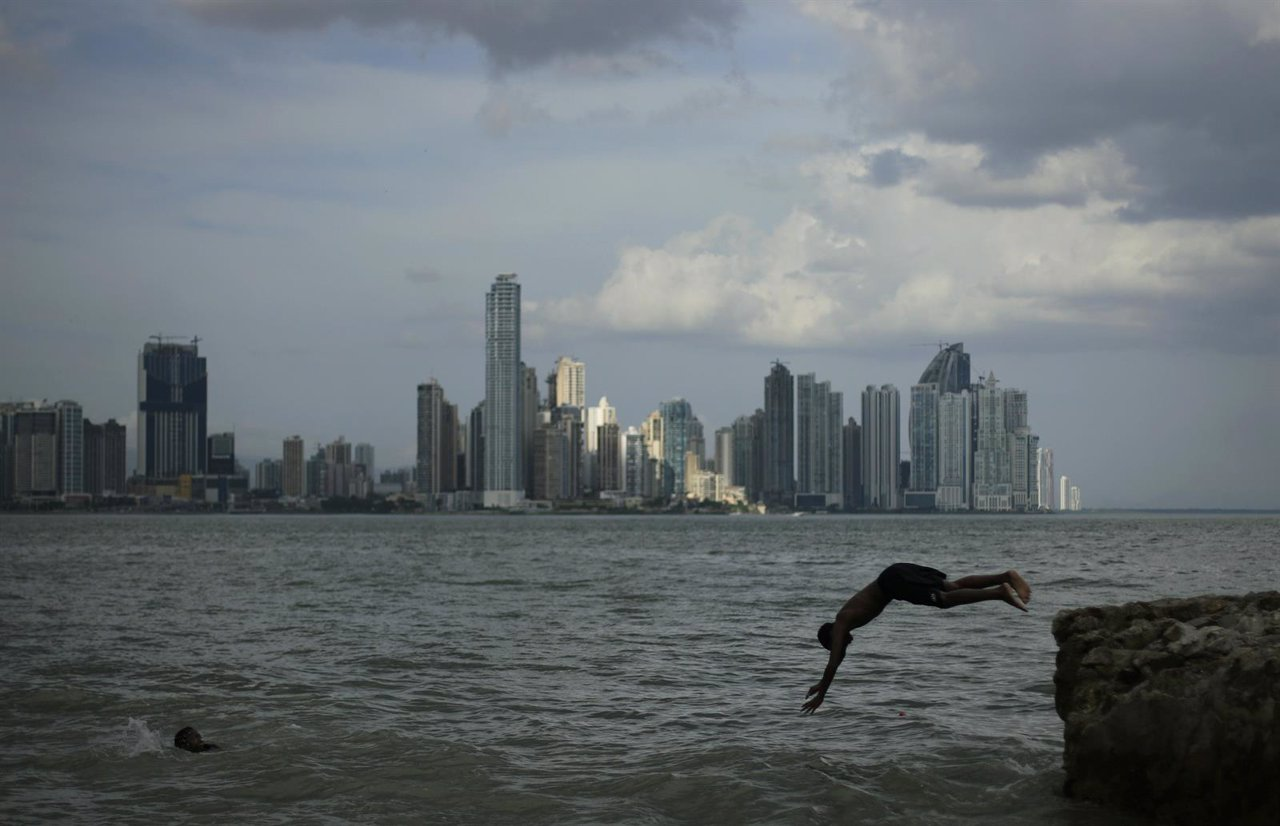 A boy jumps into the sea in the old city of Panama
