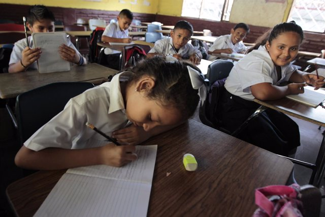 A student writes down in her note book on the first day of school in Managua