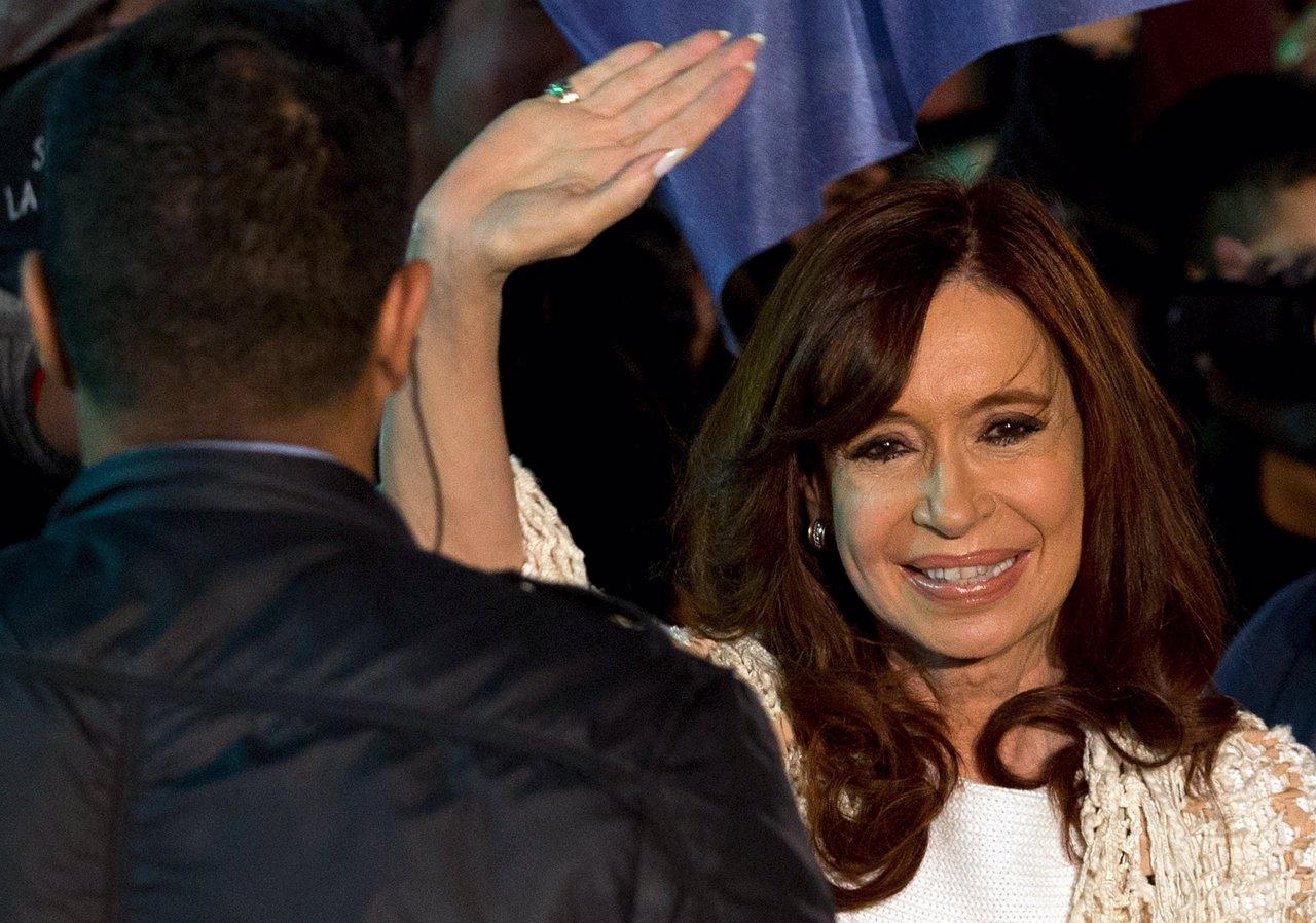 Former Argentine President Fernandez de Kirchner waves to supporters after arriv