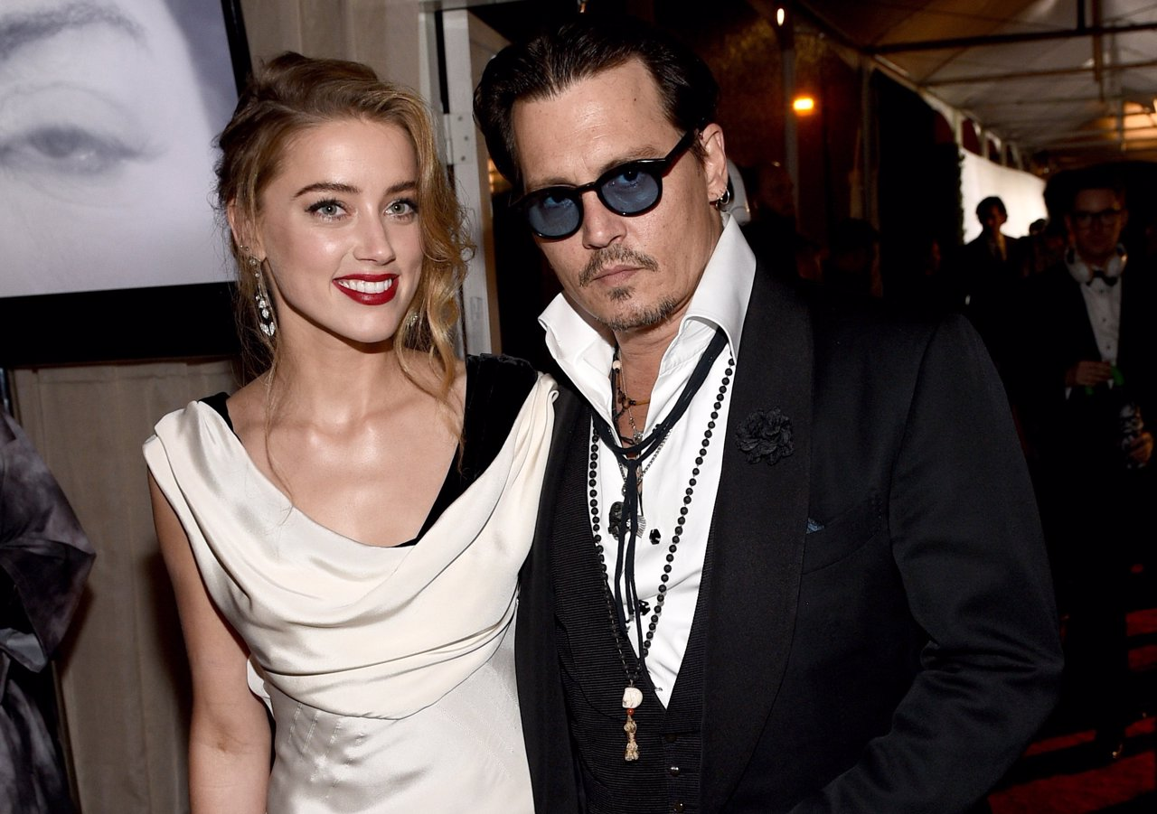 LOS ANGELES, CA - JANUARY 10: Actors Amber Heard (L) and Johnny Depp attend the