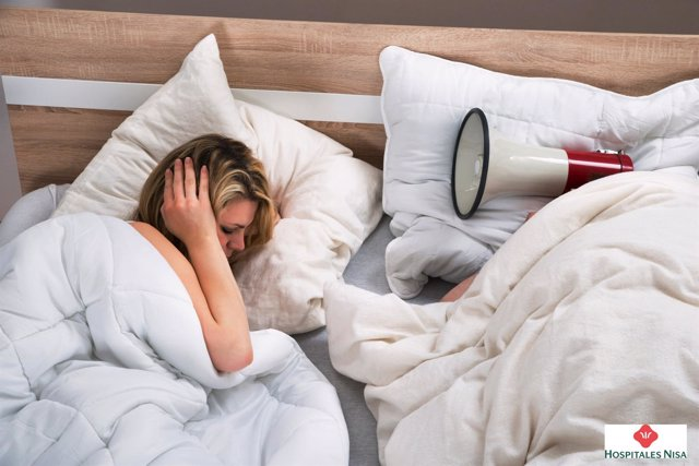 Woman Disturbed By The Snores Of Husband In The Bedroom