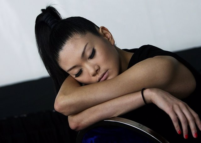 SINGAPORE - MAY 19:  A model sleeps backstage ahead of the Emanuel Ungaro show d