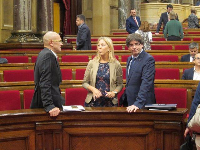 El presidente de la Generalitat C.Puigdemont y los consellers R.Romeva y N.Munté