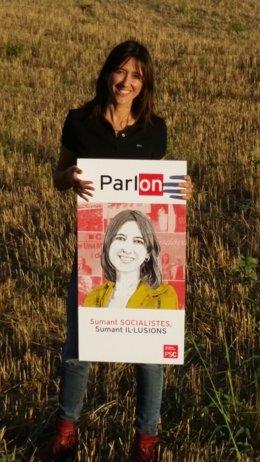 Nuria Parlon, con el cartel de su candidatura al PSC