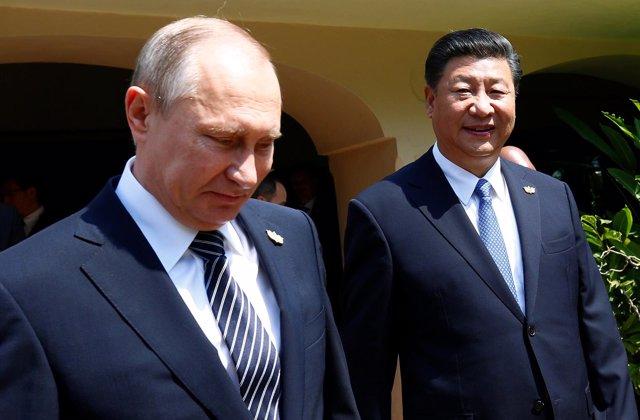 El presidente ruso, Vladimir Putin, y su homólogo chino, Xi Jinping