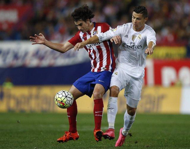 Cristiano Ronaldo y Tiago, en un partido de liga Atlético de Madrid-Real Madrid