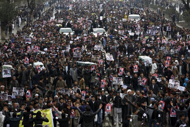 People attend a protest against the killing of seven people from the Hazara comm