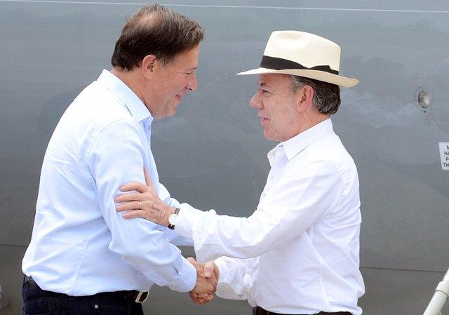Juan Manuel Santos y Juan Carlos Varela