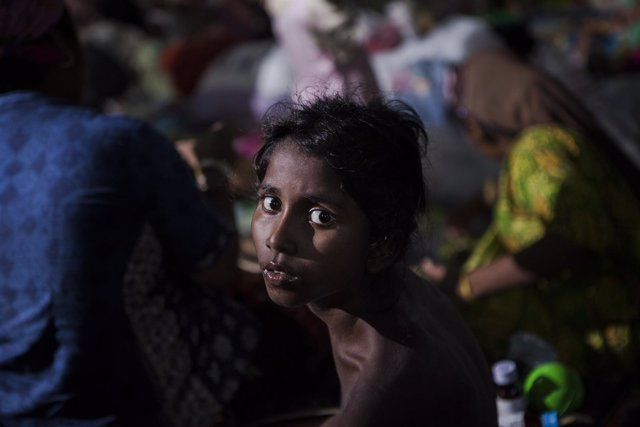 Nur Kaida, a Rohingya child from Myanmar is seen in a confinement area in Kuala