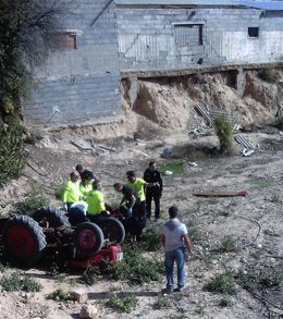 Atrapado bajo un tractor, accidente