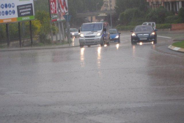 Coches Con Lluvia, Tráfico Urbano