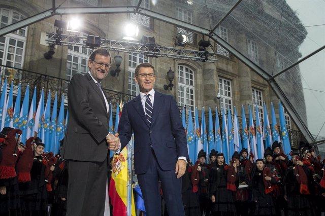 Rajoy y Feijóo en el acto de celebración tras la toma de posesión