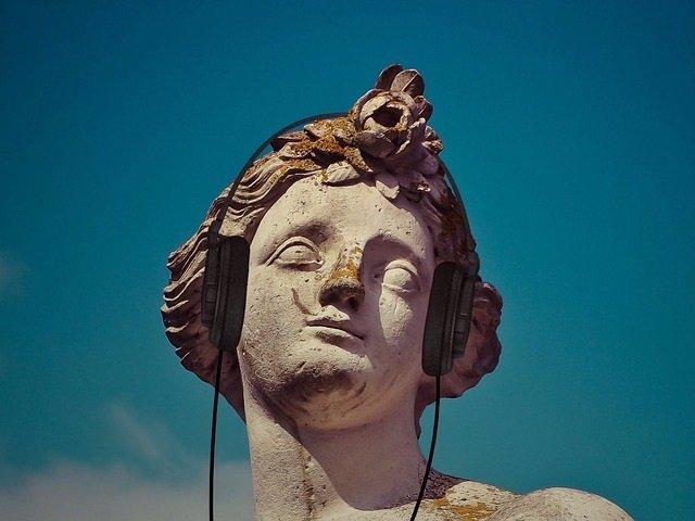 Música, estatua, auriculares, anhedonia