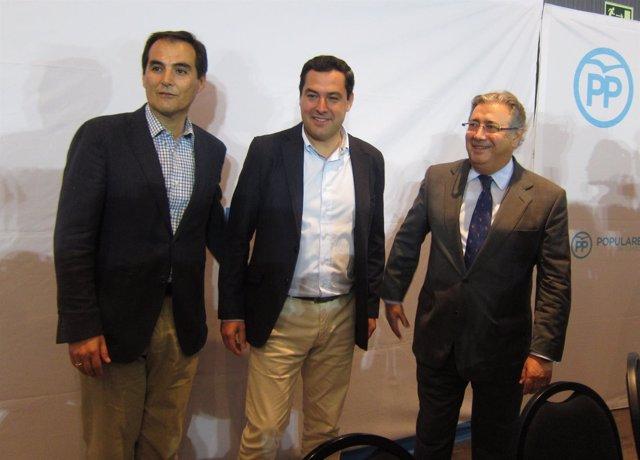 José Antonio Nieto con Juan Ignacio Zoido y Juanma Moreno