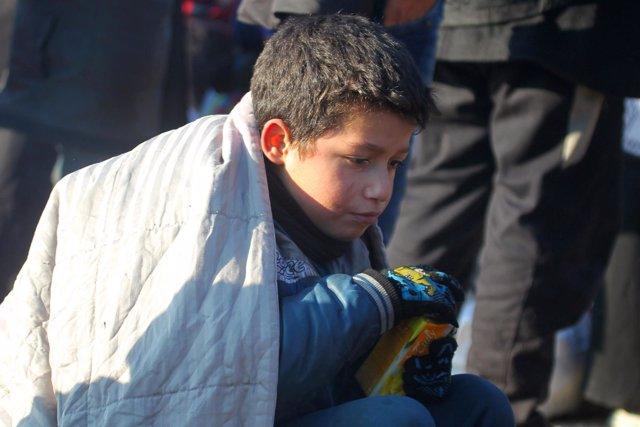 Un niño evacuado del este de Alepo