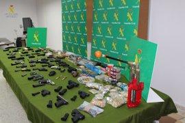 Diez detenidos de una red de tráfico de armas en Sevilla y Córdoba