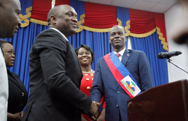 Haitian President Jovenel Moise shakes hands with the President of the Haitian P