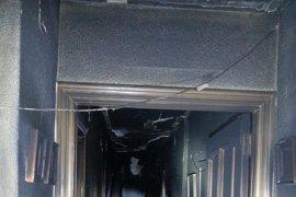 La Policía Local salva a dos ancianos atrapados en el incendio de su piso en Valencia