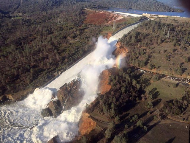 A damaged spillway with eroded hillside is seen in an aerial photo taken over th