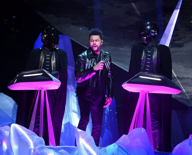LOS ANGELES - FEBRUARY 12: The Weeknd (C) and Daft Punk perform onstage at the 5