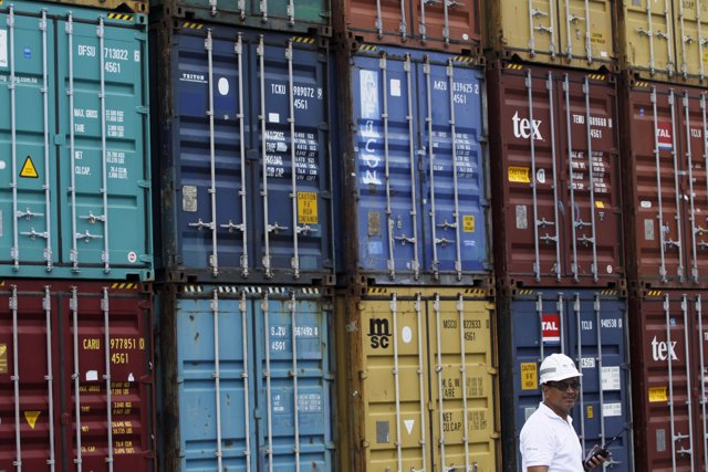 A Panama Ports Company employee is seen next to containers at the Balboa port in