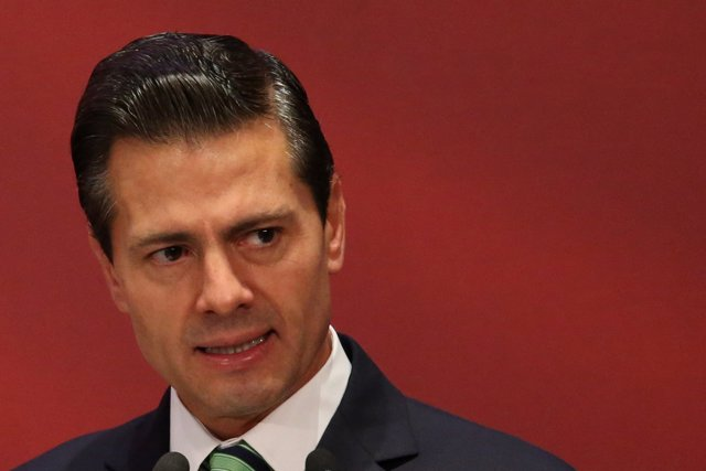 "Mexico's President Enrique Pena Nieto reacts during a ""Made in Mexico"" event in"