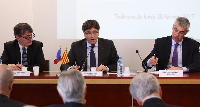 El pte.C.Puigdemont con los representantes de MEDEF P.Robardey y L.Boissonade.