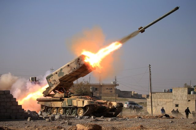 Iraqi army launch a rocket towards Islamic State militants during a battle with
