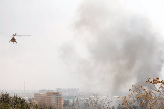 Smoke rises from a military hospital at the site of blast and gunfire in Kabul,