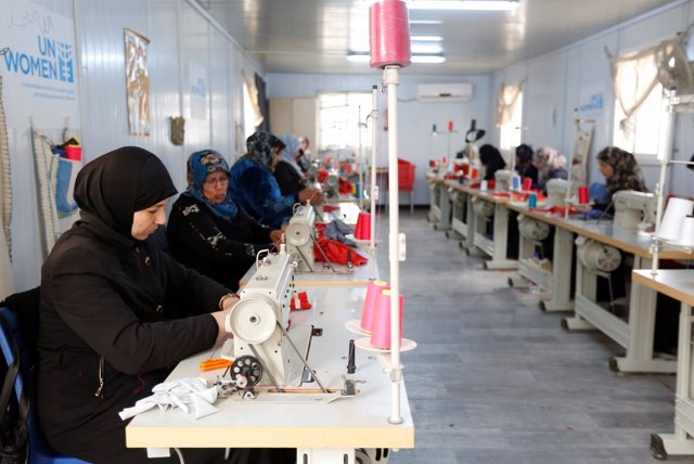 Syrian women working in a sewing workshop in the U.N. Women center at Al Zaatari