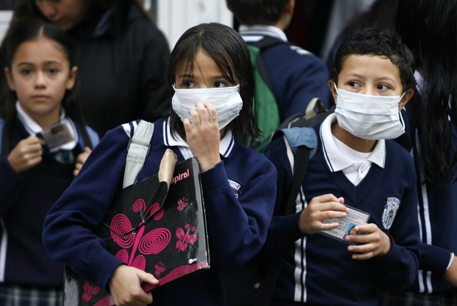 Students wear masks in Bogota May 4, 2009. Colombia on Sunday reported its first