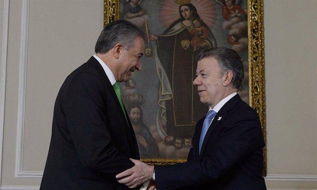Þóscar Naranjo y Juan Manuel Santos