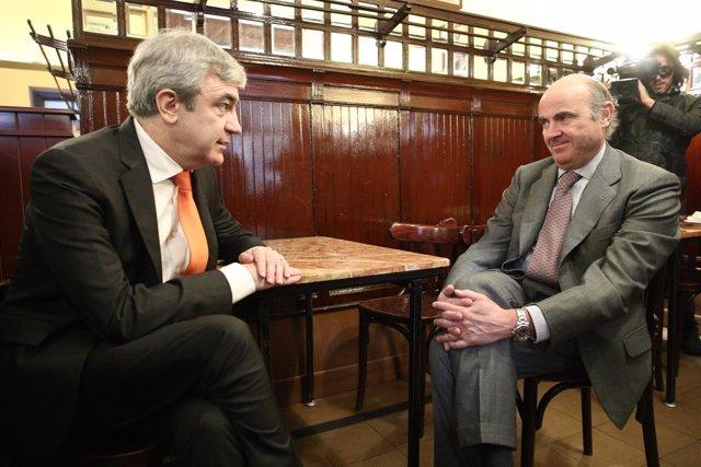 Luis Garicano y el ministro Luis de Guindos se reúnen