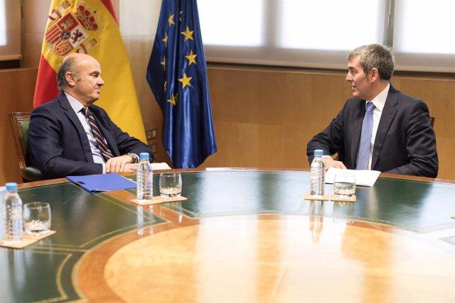Luis de Guindos y Fernando Clavijo
