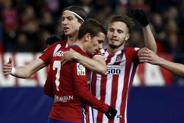 Griezmann, Saúl, y Filipe celebran un gol del Atlético