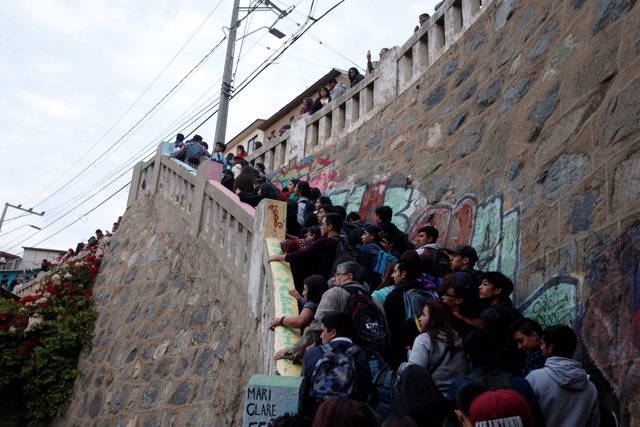 People walk up stairs after a mass evacuation of the entire coastline during a t