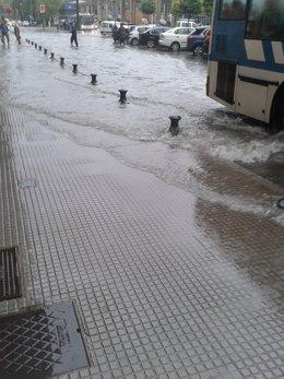 Imagen de una calle de Huelva tras las intensas lluvias.