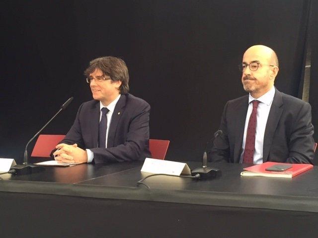 Carles Puigdemont (Generalitat) y J.A.García (CSC)