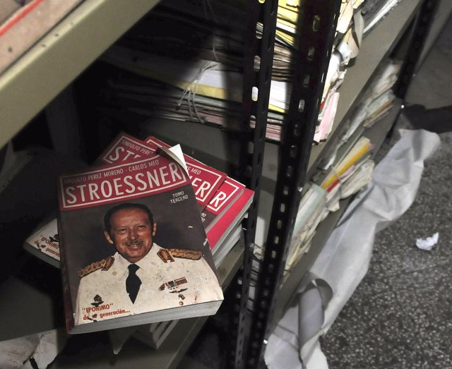 A book with the picture of the dictator Alfredo Stroessner is seen from military