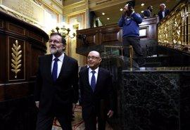 """Rajoy, """"satisfecho"""" tras salvar el primer trámite de los PGE, buscará el apoyo de NC y más grupos para aprobarlos"""
