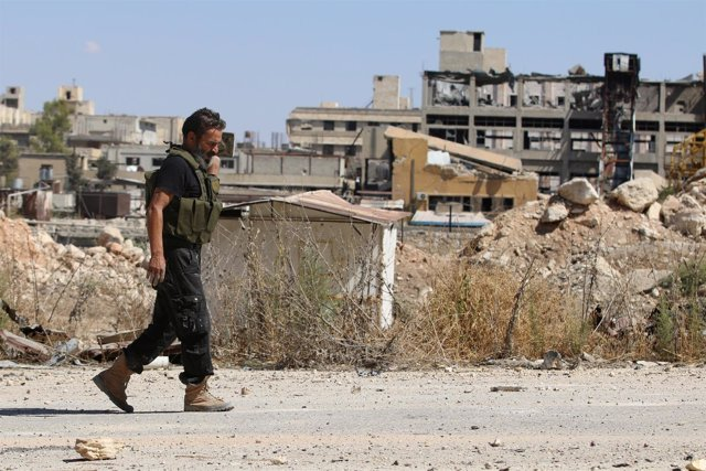 Miliciano rebelde en Alepo