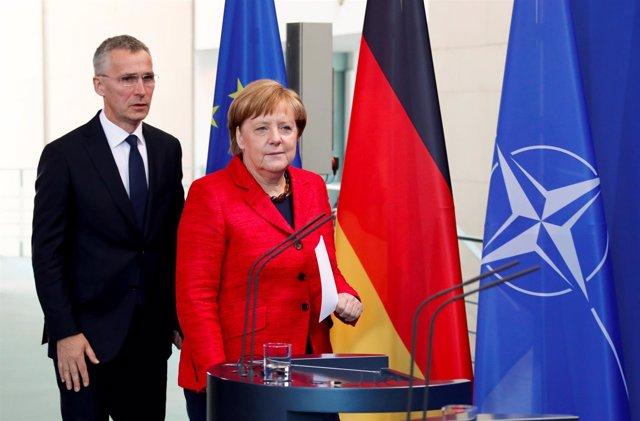 Angela Merkel y Jens Stoltenberg