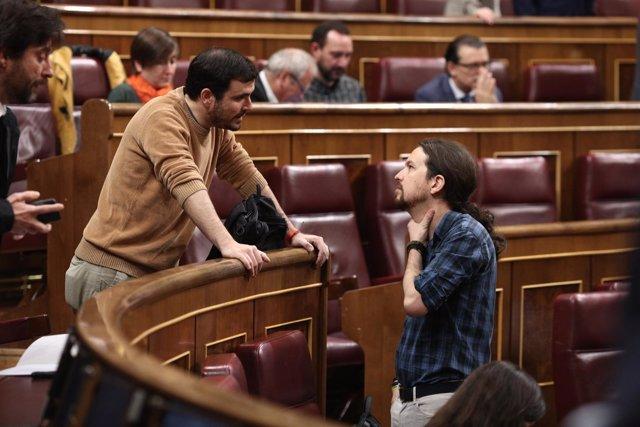 Alberto Garzón y Pablo Iglesias en el pleno en el Congreso